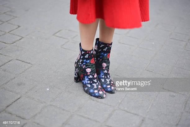 Brenda Diaz de la Vega poses wearing a Ferragamo dress and Valentino shoes before the Miu Miu show at the Palais de Iena during Paris Fashion Week...