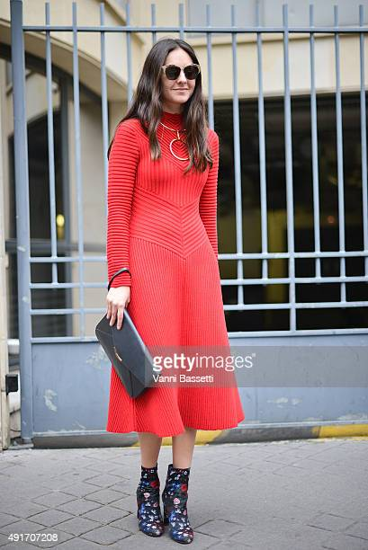 Brenda Diaz de la Vega poses wearing a Ferragamo dress Valentino shoes and Fendi clutch before the Miu Miu show at the Palais de Iena during Paris...