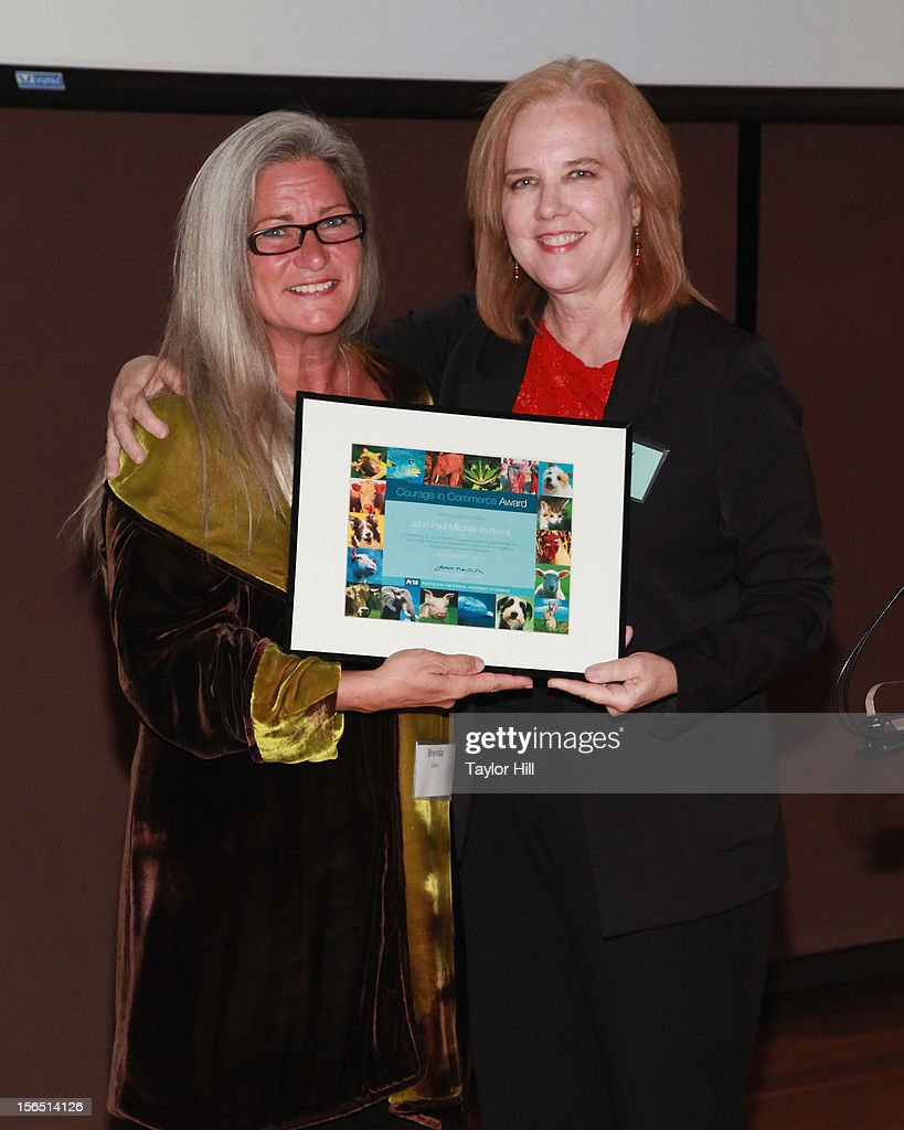 Brenda DuVal, Senior Vice President of Research and Development for John Paul Mitchell Systems, accepts an award from PETA Senior Vice President, Laboratory Investigations Kathy Guillermo as they attend a PETA Fundraiser at The Standard Hotel on November 15, 2012 in New York City.