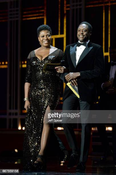 Brenda Edwards and Matt Henry present an award on stage during The Olivier Awards 2017 at Royal Albert Hall on April 9 2017 in London England