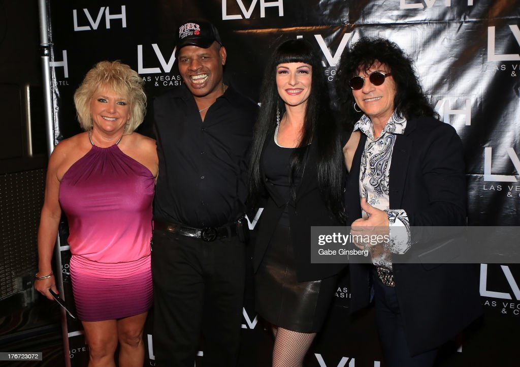 Brenda Glur-Spinks, former boxer and honoree Leon Spinks, Carmen Shortino and her husband, singer Paul Shortino arrive at the 'Night of the Champion' event to honor former boxer Leon Spinks hosted by the cast members of 'Raiding the Rock Vault' at The Las Vegas Hotel & Casino on August 17, 2013 in Las Vegas, Nevada.