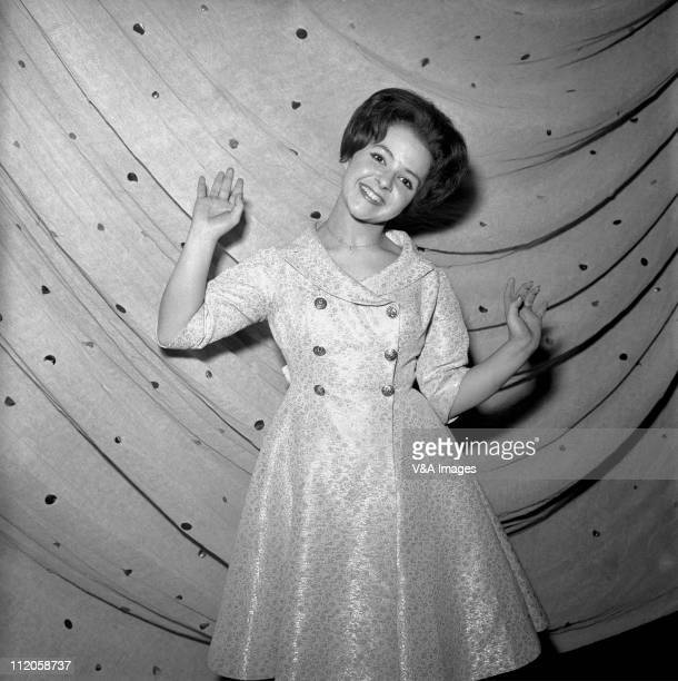 Brenda Lee posed backstage 1960