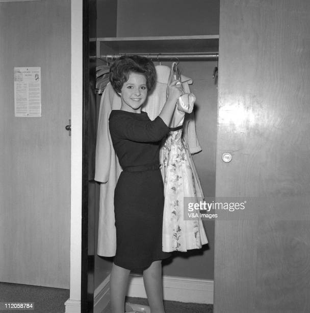 Brenda Lee posed backstage with dresses 1960