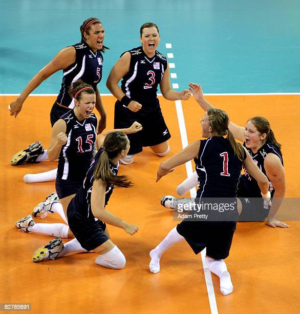 Brenda Maymon an team USA celebrate a point during the Sitting Volleyball match between the USA and the Netherlands at China Agricultural Gymnasium...