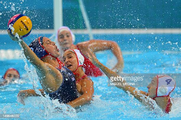 US' Brenda Villa is challenged by Spain's Anni Espar Llaquet and Roser Tarrago Aymerich in the women's water polo preliminary round groupe A match...