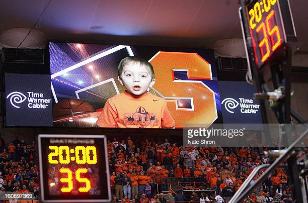 Brendan a four year old fan of the Syracuse Orange is seen on the jumbotron announcing the lineup prior to the game against the Notre Dame Fighting...
