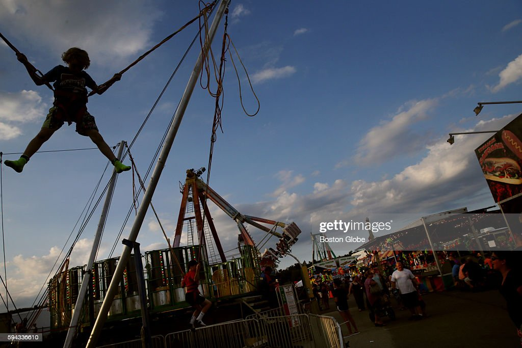 Brendan Abban of Pembroke takes a turn on the Euro Bungee at the Marshfield Fair in Marshfield Mass on Aug 19 2016 Now in its 149th year the fair...