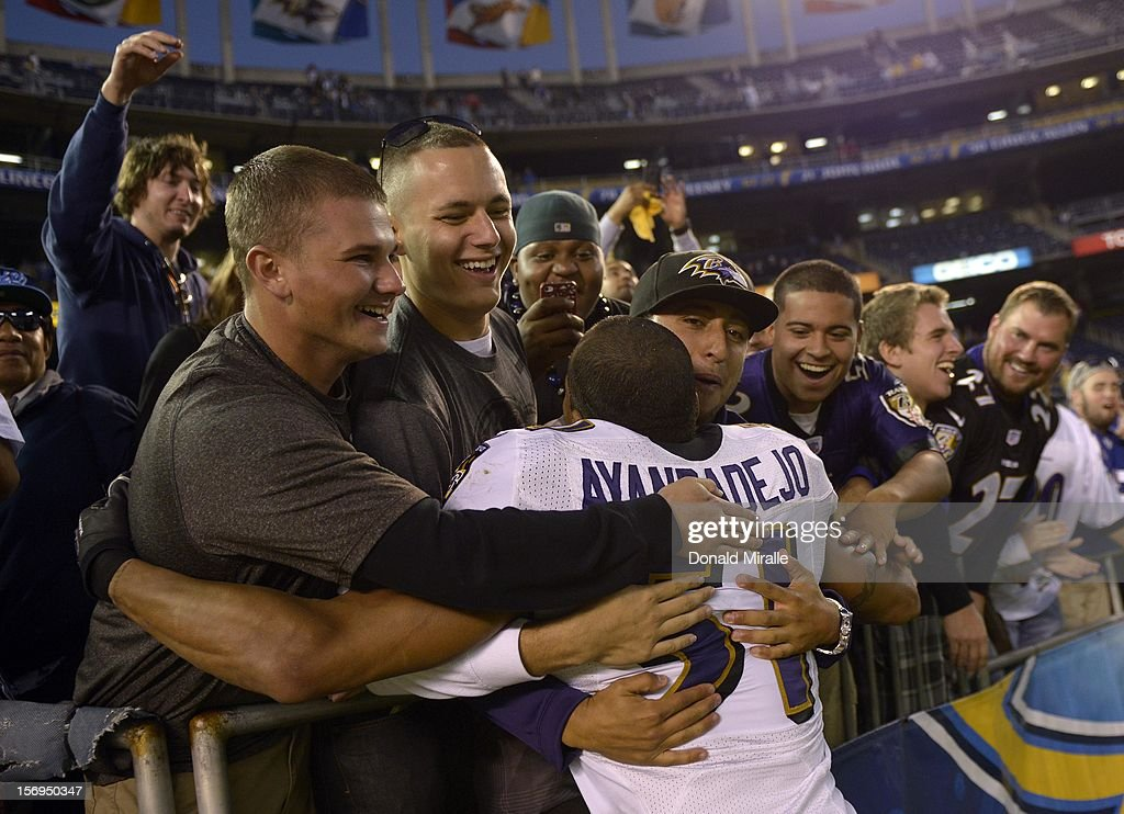 Brendan Ayanbadejo #51 of the Baltimore Ravens is hugged by fans after his team's 16-13 overtime win over the San Diego Chargers on November 25, 2012 at Qualcomm Stadium in San Diego, California.