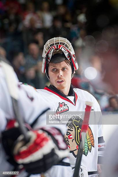 Brendan Burke of Portland Winterhawks stands at the bench during a time out against the Kelowna Rockets on November 21 2014 at Prospera Place in...
