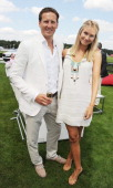 Brendan Cole and Zoe Hobbs attend the Audi International Guards Polo at Guards Polo Club on July 22 2012 in Egham United Kingdom