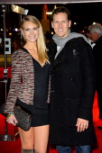 Brendan Cole and Zoe Hobbs attend the UK Premiere of 'The Hunger Games Catching Fire' at Odeon Leicester Square on November 11 2013 in London England