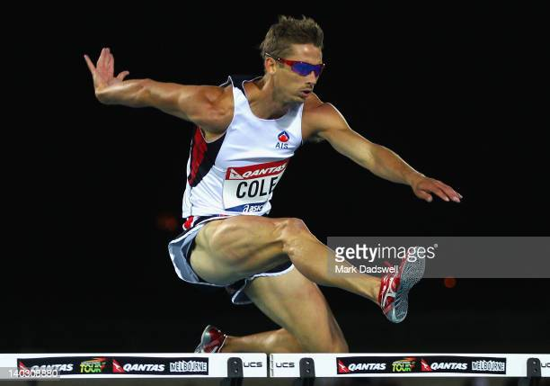 Brendan Cole of Australia on his way to an Olympic Qualifier in the 400 Metres Hurdles Open Men during day one of the Melbourne Track Classic/IAAF...