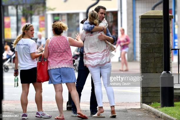 Brendan Cox husband of murdered MP Jo Cox and Kim Leadbeater sister of Jo Cox and founder of the MoreInCommon movement recieve hugs as they leave a...