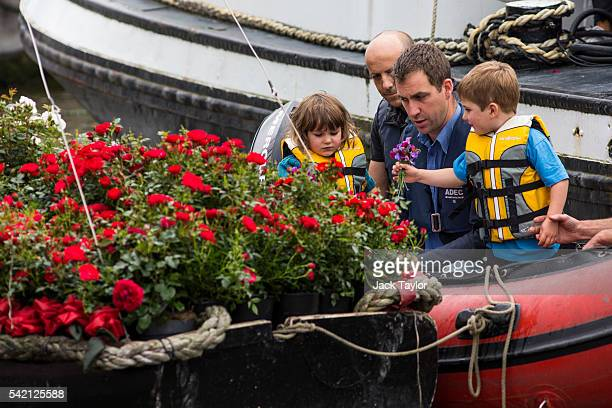 Brendan Cox the widower of MP Jo Cox and their two children Cuillin 5 and Lejla 3 prepare to join a floating commemoration at Hermitage Moorings on...