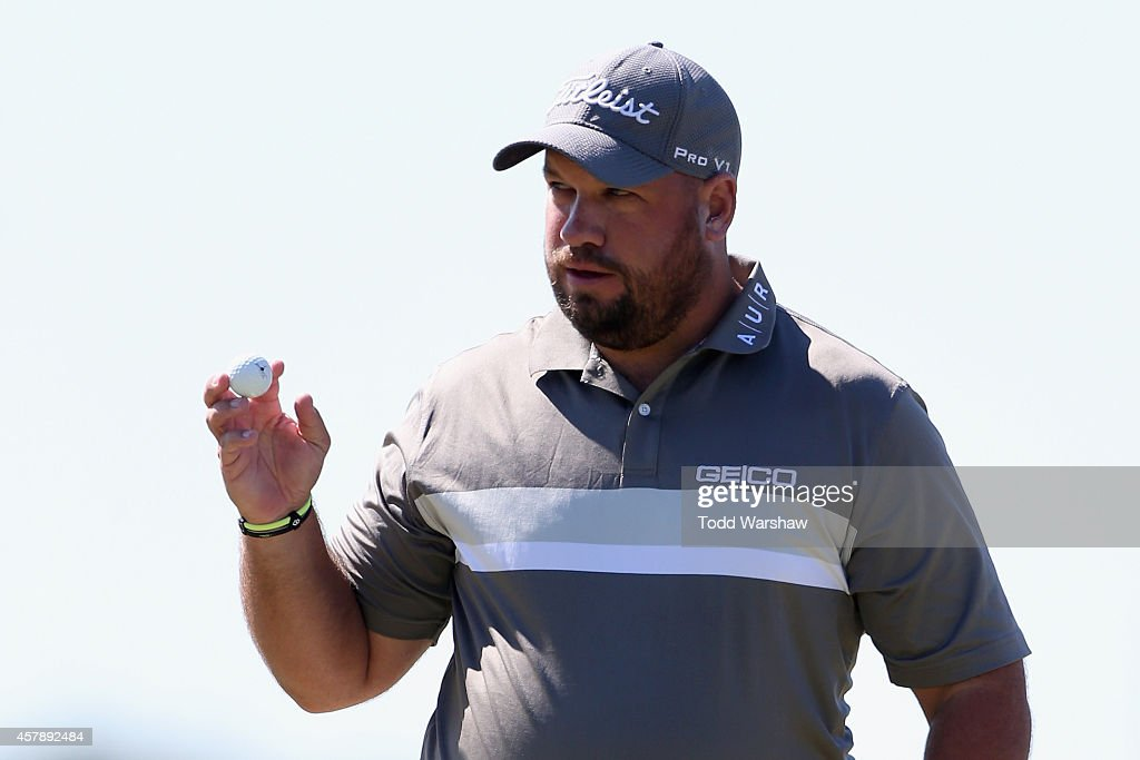 Brendan de Jonge of Zimbabwe acknowledges the crowd after a birdie putt on the first hole during the final round of The McGladrey Classic at Sea...
