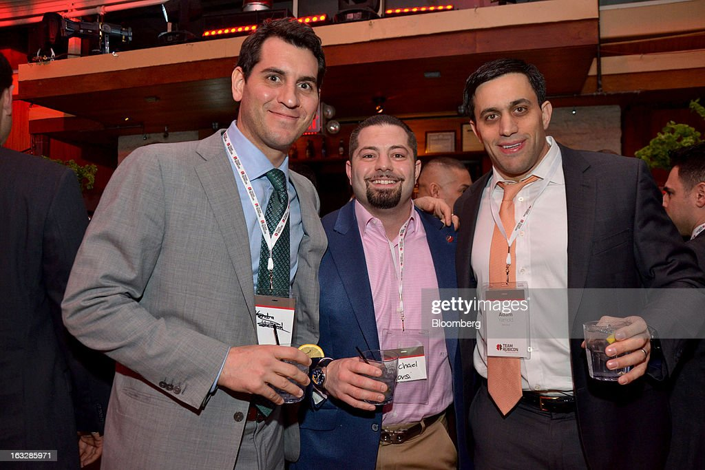 Brendan Donnelly, vice president of mortgage sales at Merrill Lynch, from left, Michael Corsi, director of RBC Capital Markets LLC, and Adam Yarnold, managing director of mortgage credit business at Barclays Plc and board member of Team Rubicon, attend a fundraiser for Team Rubicon at Hudson Terrace nightclub in New York, U.S., on Tuesday, March 5, 2013. Los Angeles-based non profit Team Rubicon deploys veterans on disaster relief missions in the U.S. and abroad. Photographer: Amanda Gordon/Bloomberg via Getty Images