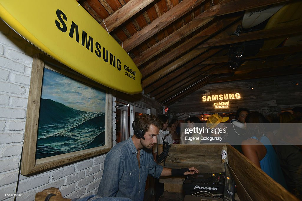 Brendan Fallis performs in the DJ booth during Samsung's Summer DJ Series to launch the Giga Sound System at Surf Lodge on July 13, 2013 in Montauk, New York.
