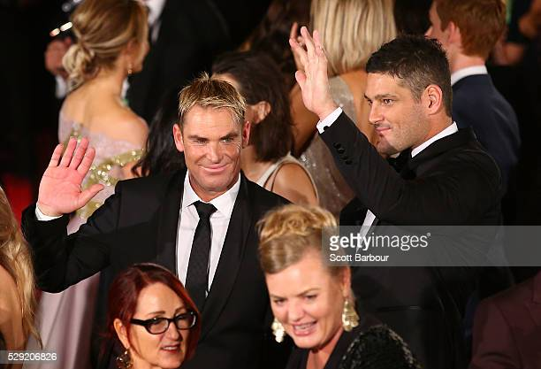 Brendan Fevola and Shane Warne look on as they arrive at the 58th Annual Logie Awards at Crown Palladium on May 8 2016 in Melbourne Australia