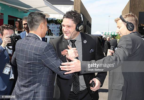 Brendan Fevola and Tim Cahill talk on Derby Day at Flemington Racecourse on October 29 2016 in Melbourne Australia