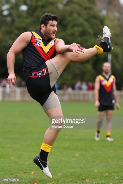 Brendan Fevola of Bacchus Marsh kicks the ball during the round six BFL match between Bacchus Marsh and Sunbury at Maddingley Park on June 1 2013 in...