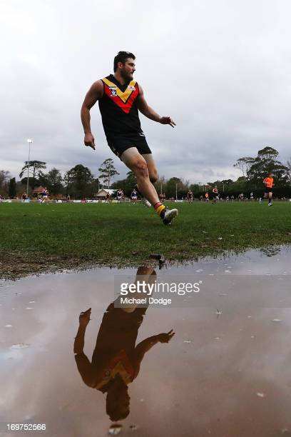 Brendan Fevola of Bacchus Marsh looks ahead after kicking the ball for a goal attempt during the round six BFL match between Bacchus Marsh and...