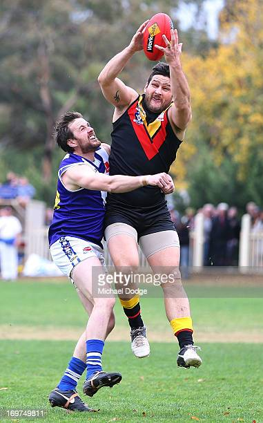 Brendan Fevola of Bacchus Marsh marks the ball during the round six BFL match between Bacchus Marsh and Sunbury at Maddingley Park on June 1 2013 in...