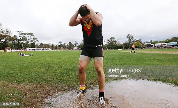 Brendan Fevola of Bacchus Marsh reacts after missing a kick for goal during the round six BFL match between Bacchus Marsh and Sunbury at Maddingley...