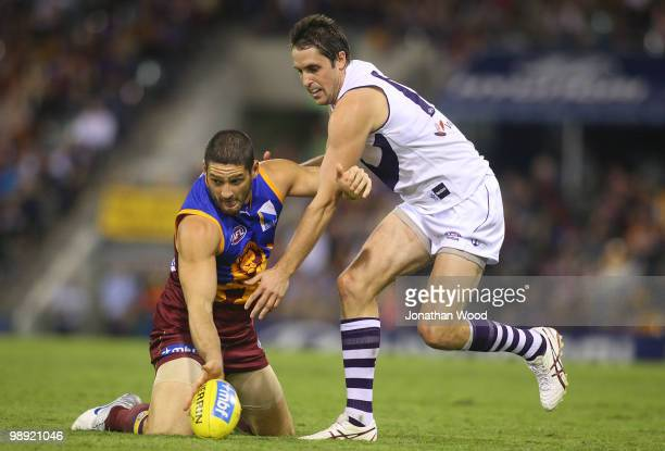 Brendan Fevola of the Lions contests the ball with Luke McPharlin of the Dockers during the round seven AFL match between the Brisbane Lions and the...
