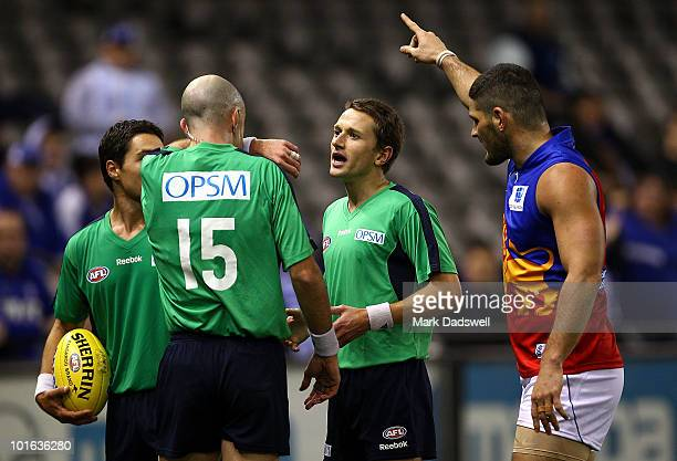 Brendan Fevola of the Lions tells Umpire Matthew Nicholls to look at the big screen replayduring the round 11 AFL match between the North Melbourne...
