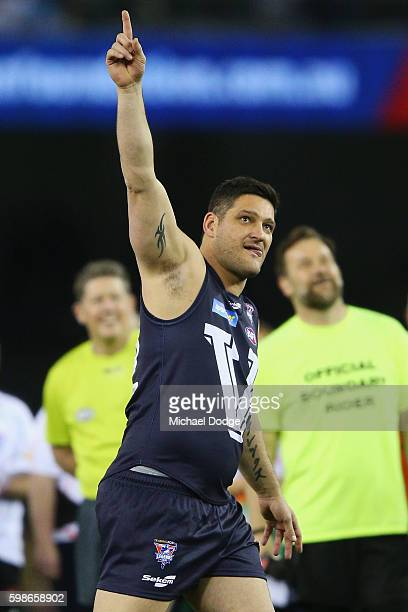 Brendan Fevola of Victoria celebrates a goal to win for the team in a shoot out during the EJ Whitten Legends match at Etihad Stadium on September 2...