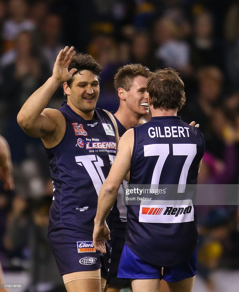 <a gi-track='captionPersonalityLinkClicked' href=/galleries/search?phrase=Brendan+Fevola&family=editorial&specificpeople=171221 ng-click='$event.stopPropagation()'>Brendan Fevola</a> of Victoria celebrates with his teammates after kicking the winning goal during the EJ Whitten Legends AFL game between Victoria and the All Stars at Etihad Stadium on July 10, 2013 in Melbourne, Australia.