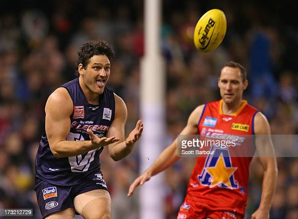 Brendan Fevola of Victoria takes a mark during the EJ Whitten Legends AFL game between Victoria and the All Stars at Etihad Stadium on July 10 2013...