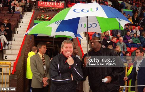 Brendan Foster has a laugh in the rain