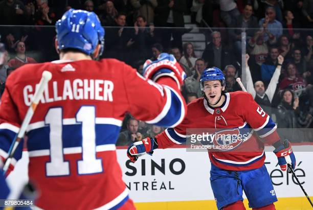 Brendan Gallagher and Charles Hudon of the Montreal Canadiens celebrate after scoring a goal against the Arizona Coyotes in the NHL game at the Bell...