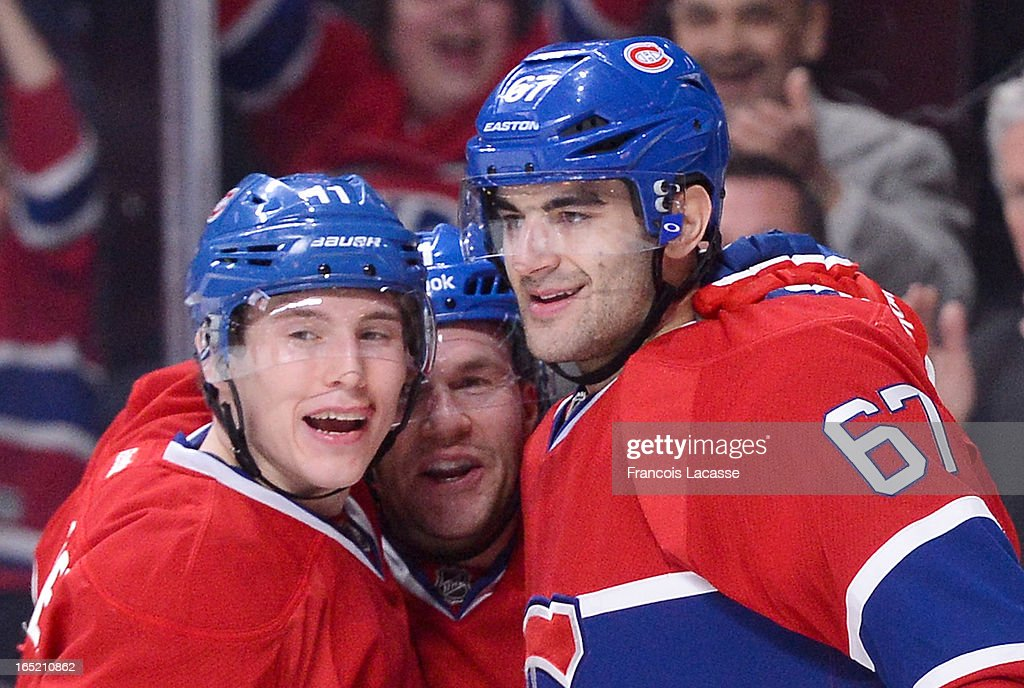 Brendan Gallagher #11, David Desharnais #51 and Max Pacioretty #67 of the Montreal Canadiens celebrate their third period goal against the Carolina Hurricanes during the NHL game on April 1, 2013 at the Bell Centre in Montreal, Quebec, Canada.