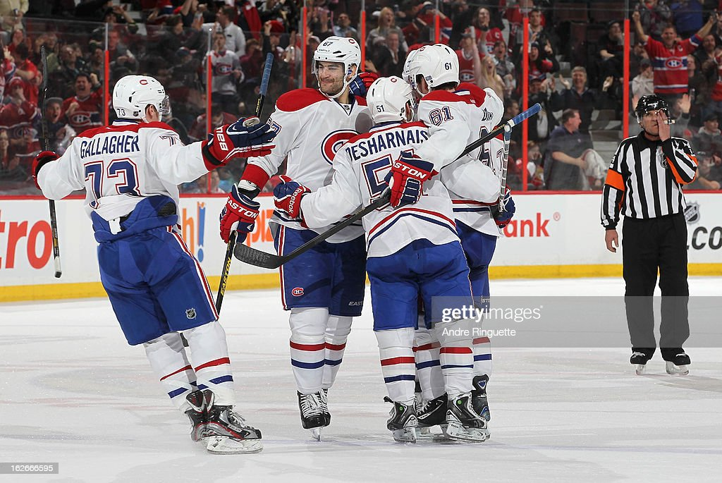 Brendan Gallagher #73, Max Pacioretty #67, David Desharnais #51 and Raphael Diaz #61 of the Montreal Canadiens celebrate a second period power-play goal against the Ottawa Senators on February 25, 2013 at Scotiabank Place in Ottawa, Ontario, Canada.
