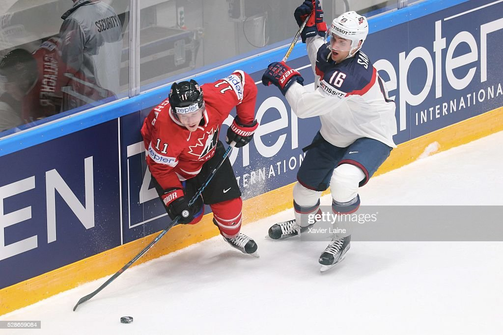 Brendan Gallagher of Canada in action with Steve Santini of USA during the 2016 IIHF World Championship between USA and Canada at Yubileyny Sports Palace ,on May 6, 2016 in Saint Petersburg, Russia.