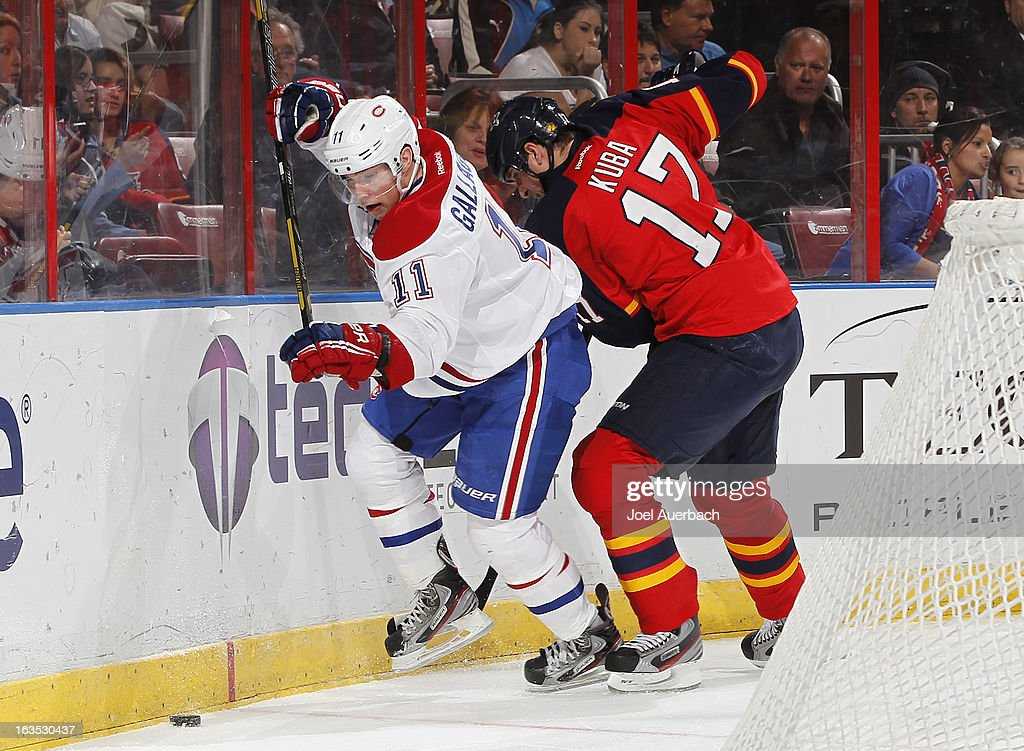 Brendan Gallagher #11 of the Montreal Canadiens and Filip Kuba #17 of the Florida Panthers skate after a loose puck at the BB&T Center on March 10, 2013 in Sunrise, Florida. (The Canadiens defeated the Panthers 5-2.