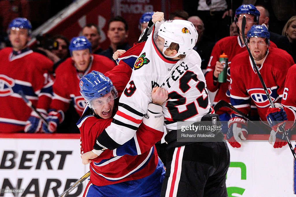 <a gi-track='captionPersonalityLinkClicked' href=/galleries/search?phrase=Brendan+Gallagher&family=editorial&specificpeople=3704208 ng-click='$event.stopPropagation()'>Brendan Gallagher</a> #11 of the Montreal Canadiens and <a gi-track='captionPersonalityLinkClicked' href=/galleries/search?phrase=Kris+Versteeg&family=editorial&specificpeople=2242969 ng-click='$event.stopPropagation()'>Kris Versteeg</a> #23 of the Chicago Blackhawks fight during the NHL game at the Bell Centre on January 11, 2014 in Montreal, Quebec, Canada.