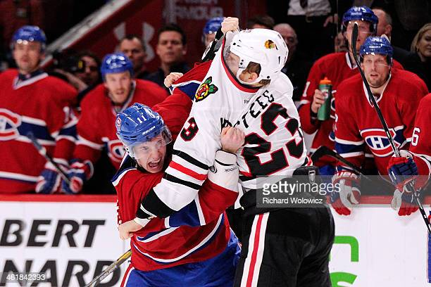 Brendan Gallagher of the Montreal Canadiens and Kris Versteeg of the Chicago Blackhawks fight during the NHL game at the Bell Centre on January 11...