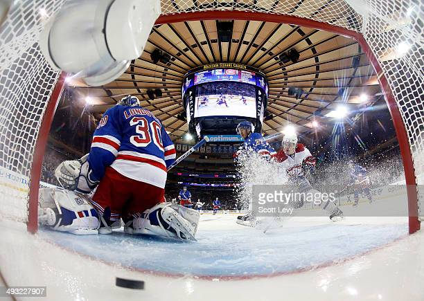 Brendan Gallagher of the Montreal Canadiens and Ryan McDonagh of the New York Rangers battle for position as Henrik Lundqvist of the New York Rangers...