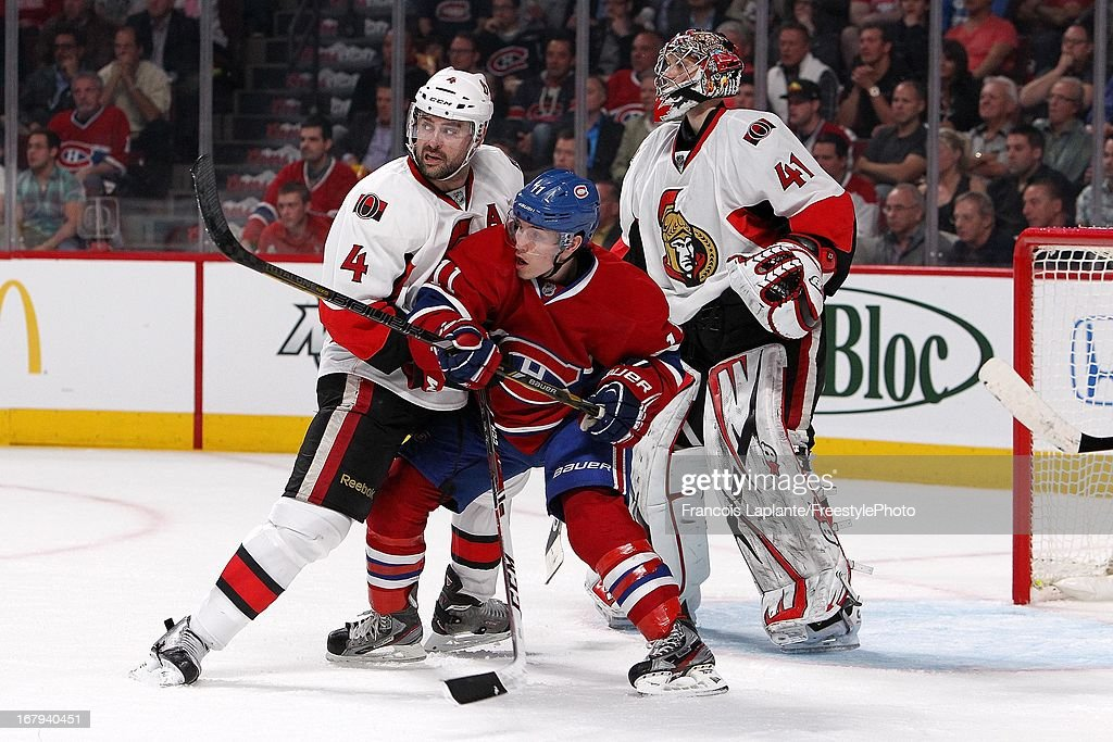 <a gi-track='captionPersonalityLinkClicked' href=/galleries/search?phrase=Brendan+Gallagher&family=editorial&specificpeople=3704208 ng-click='$event.stopPropagation()'>Brendan Gallagher</a> #11 of the Montreal Canadiens battles for position against Chris Phillips #4 of the Ottawa Senators as Craig Anderson #41 looks on during Game One of the Eastern Conference Quarterfinal during the 2013 NHL Stanley Cup Playoffs at the Bell Centre on May 2, 2013 in Montreal, Quebec, Canada.