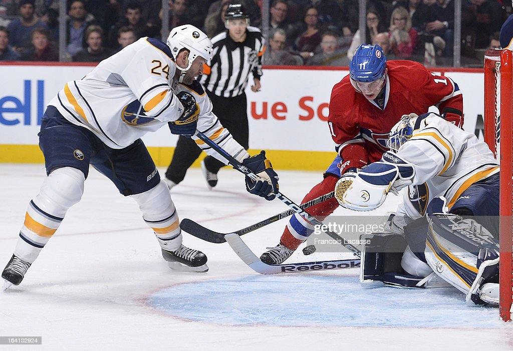 <a gi-track='captionPersonalityLinkClicked' href=/galleries/search?phrase=Brendan+Gallagher&family=editorial&specificpeople=3704208 ng-click='$event.stopPropagation()'>Brendan Gallagher</a> #11 of the Montreal Canadiens battles for the puck with <a gi-track='captionPersonalityLinkClicked' href=/galleries/search?phrase=Robyn+Regehr&family=editorial&specificpeople=171828 ng-click='$event.stopPropagation()'>Robyn Regehr</a> #24 and goaltender <a gi-track='captionPersonalityLinkClicked' href=/galleries/search?phrase=Jhonas+Enroth&family=editorial&specificpeople=570456 ng-click='$event.stopPropagation()'>Jhonas Enroth</a> #1 of the Buffalo Sabres during the NHL game on March 19, 2013 at the Bell Centre in Montreal, Quebec, Canada.
