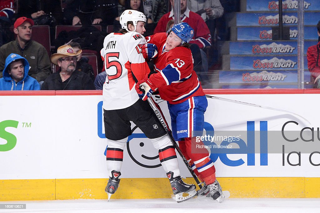 Brendan Gallagher #73 of the Montreal Canadiens body checks Zack Smith #15 of the Ottawa Senators during the NHL game at the Bell Centre on February 3, 2013 in Montreal, Quebec, Canada. The Canadiens defeated the Senators 2-1.