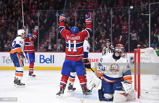 Brendan Gallagher of the Montreal Canadiens celebrates after scoring a goal against Jaroslav Halak of the New York Islanders in the NHL game at the...