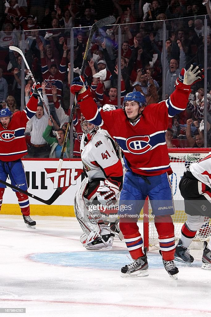 <a gi-track='captionPersonalityLinkClicked' href=/galleries/search?phrase=Brendan+Gallagher&family=editorial&specificpeople=3704208 ng-click='$event.stopPropagation()'>Brendan Gallagher</a> #11 of the Montreal Canadiens celebrates his game winning goal against as <a gi-track='captionPersonalityLinkClicked' href=/galleries/search?phrase=Craig+Anderson&family=editorial&specificpeople=211238 ng-click='$event.stopPropagation()'>Craig Anderson</a> #41 of the Ottawa Senators reacts in Game Two of the Eastern Conference Quarterfinals during the 2013 NHL Stanley Cup Playoffs at the Bell Centre on May 3, 2013 in Montreal, Quebec, Canada.
