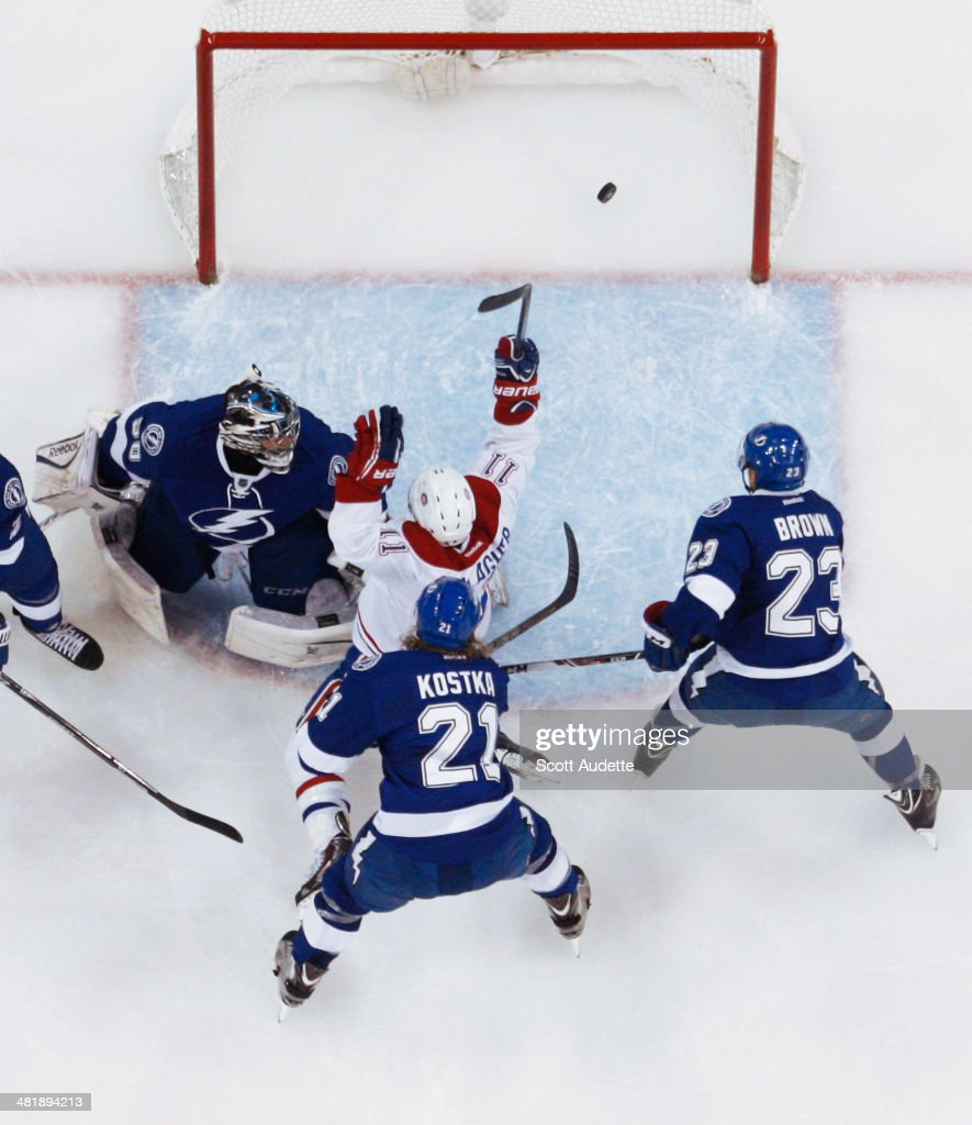 <a gi-track='captionPersonalityLinkClicked' href=/galleries/search?phrase=Brendan+Gallagher&family=editorial&specificpeople=3704208 ng-click='$event.stopPropagation()'>Brendan Gallagher</a> #11 of the Montreal Canadiens celebrates his goal against goalie <a gi-track='captionPersonalityLinkClicked' href=/galleries/search?phrase=Ben+Bishop&family=editorial&specificpeople=700137 ng-click='$event.stopPropagation()'>Ben Bishop</a> #30, <a gi-track='captionPersonalityLinkClicked' href=/galleries/search?phrase=Mike+Kostka&family=editorial&specificpeople=2193393 ng-click='$event.stopPropagation()'>Mike Kostka</a> #21, and J.T. Brown #23 of the Tampa Bay Lightning during the first period at the Tampa Bay Times Forum on April 1, 2014 in Tampa, Florida.