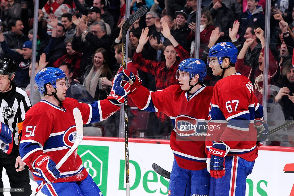 Brendan Gallagher #11 of the Montreal Canadiens celebrates his second period goal with teammates during the NHL game against the New York Rangers at the Bell Centre on March 30, 2013 in Montreal, Quebec, Canada.