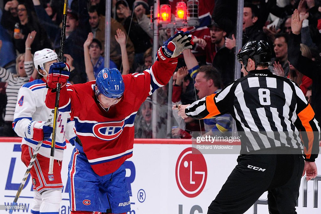 <a gi-track='captionPersonalityLinkClicked' href=/galleries/search?phrase=Brendan+Gallagher&family=editorial&specificpeople=3704208 ng-click='$event.stopPropagation()'>Brendan Gallagher</a> #11 of the Montreal Canadiens celebrates his second period goal during the NHL game against the New York Rangers at the Bell Centre on March 30, 2013 in Montreal, Quebec, Canada. The Canadiens defeated the Rangers 3-0.