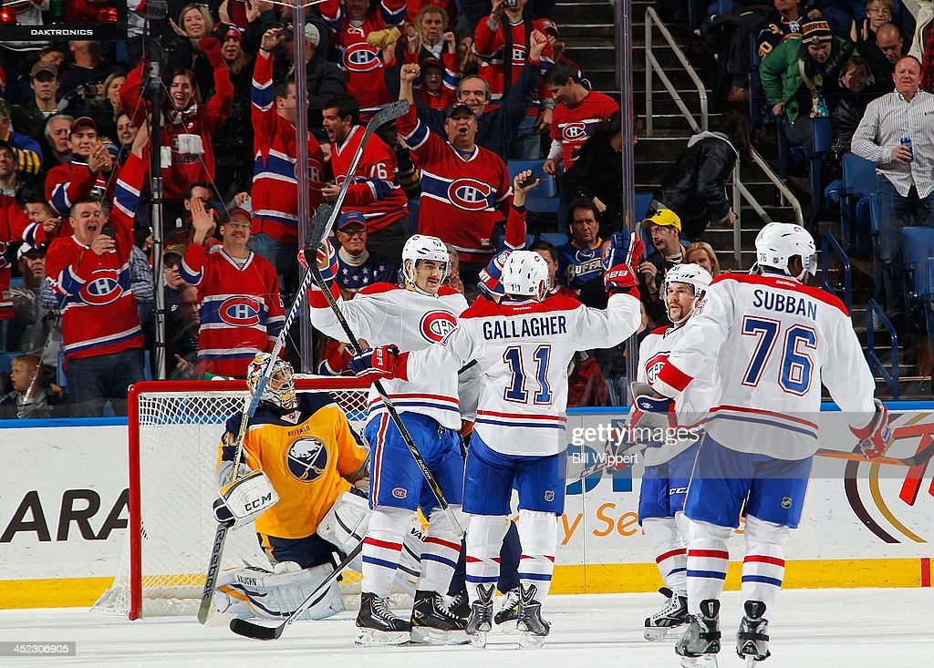 <a gi-track='captionPersonalityLinkClicked' href=/galleries/search?phrase=Brendan+Gallagher&family=editorial&specificpeople=3704208 ng-click='$event.stopPropagation()'>Brendan Gallagher</a> #11 of the Montreal Canadiens celebrates his third period goal with <a gi-track='captionPersonalityLinkClicked' href=/galleries/search?phrase=Max+Pacioretty&family=editorial&specificpeople=4324972 ng-click='$event.stopPropagation()'>Max Pacioretty</a> #67 as goaltender Ryan Miller #30 of the Buffalo Sabres reacts on November 27, 2013 at the First Niagara Center in Buffalo, New York. Montreal won, 3-1.